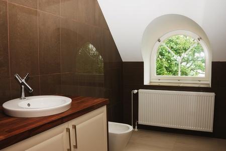 modern bathroom with window, tub, sink, steam radiator photo