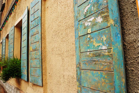 windows of antique house decorated with flowers photo