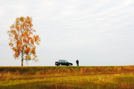 stoppage: one person close to the car in autumn