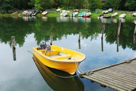 yellow boat tied up at the seashore