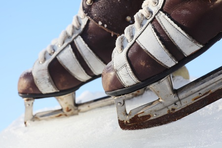 vintage pair of mens  skates on the ice photo