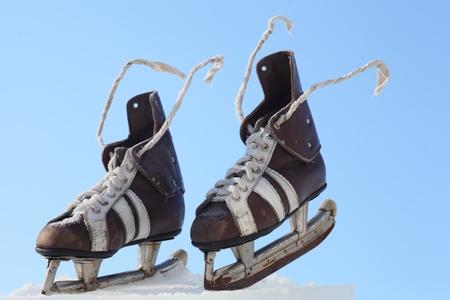 vintage pair of mens  skates on the ice photo