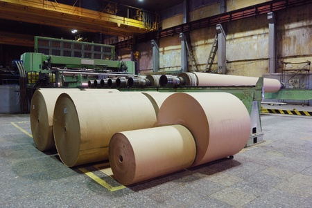 factory machine: rolls of kraft paper in the workshop    Stock Photo