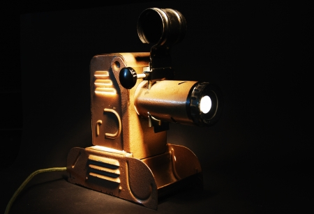 vintage slide projector with the light in dark room photo
