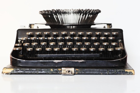 ancient portable typewriter over white background, front view Stock Photo - 13185286