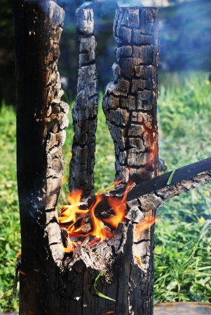 burned out: smouldering tree trunk burned out in the middle Stock Photo