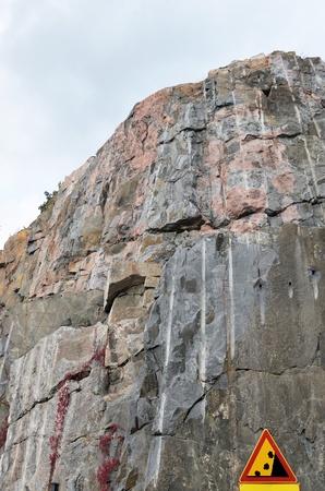 rockfall: road sign waring about falling stones, rocks