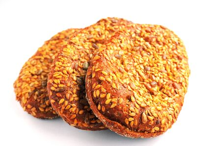 three sandwich buns with sesame seeds over white photo