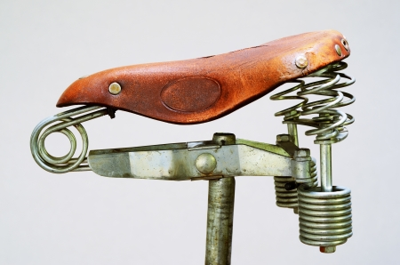 springs: old-fashioned vintage leather bike saddle with metal spring