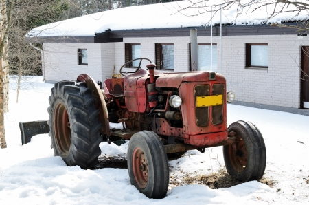 old red tractor on a farm in winter Stock Photo - 19294778