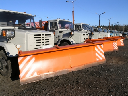 autotruck: row of new snow plows in anticipation of winter         Stock Photo
