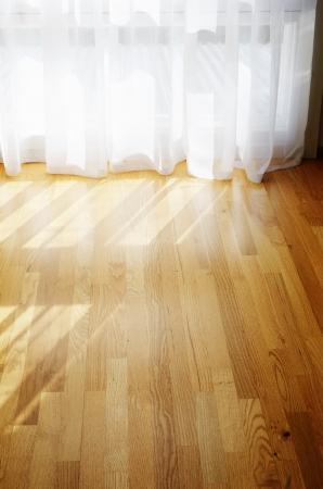 empty room, parquet flooring, transparent curtains