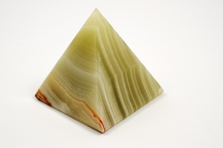 small pyramid of jasper on a white background photo