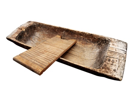 old wooden trough and washboard on a white background