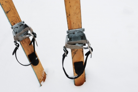 old wooden skis in the snow, horizontal