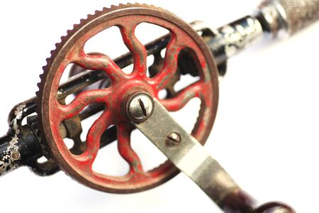 hand crank: old hand drill with crank on white
