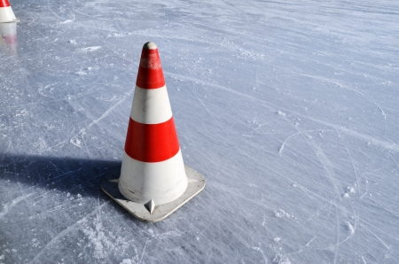 red white striped cones on the ice rink, horizontal Stock Photo - 21453728