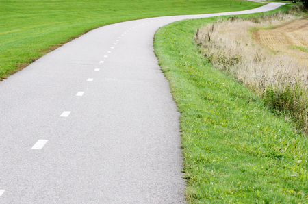 empty asphalt bike path in the country Stock Photo
