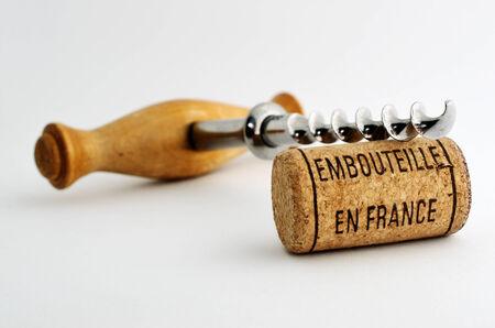 vintage old corkscrew and wine cork with inscription embouteille en France Standard-Bild