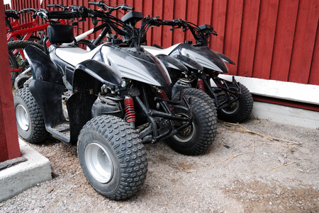 two ATVs outdoor near the house, horizontal photo
