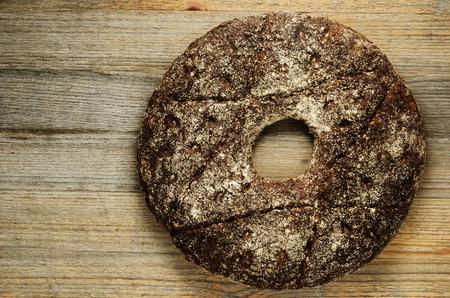 finnish traditional round ray bread on a wooden board Standard-Bild