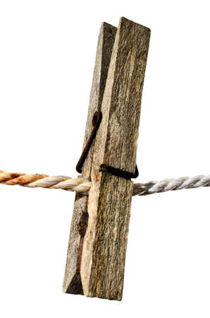 old wooden clothes peg on a rope Stock Photo