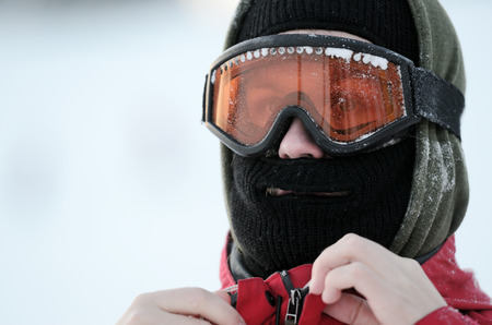 portrait of a snowboarder in goggles and mask photo