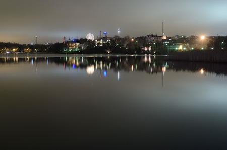 night Helsinki, capital of Finland, the reflection in the water photo