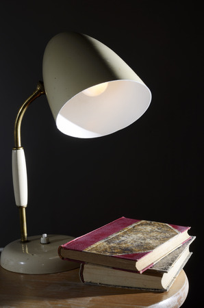 vintage table lamp and a few old books photo