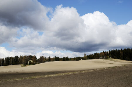 landscape with plowed field in spring, Finland photo