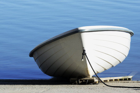 shallop: white shallop on a background of calm water
