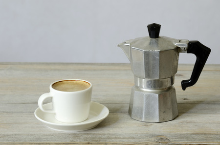 percolator: cup of coffee and percolator on wood