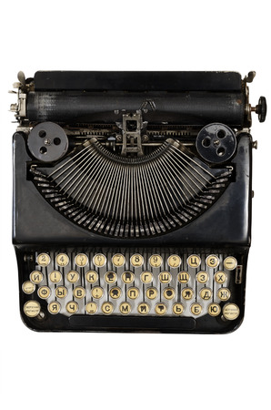 vintage portable typewriter with Cyrillic letters on white