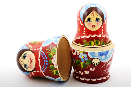 two traditional Russian matryoshka dolls on white background