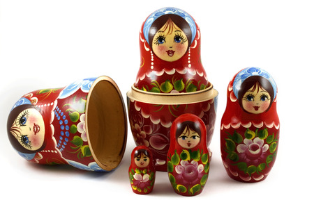 five traditional Russian matryoshka dolls on white background