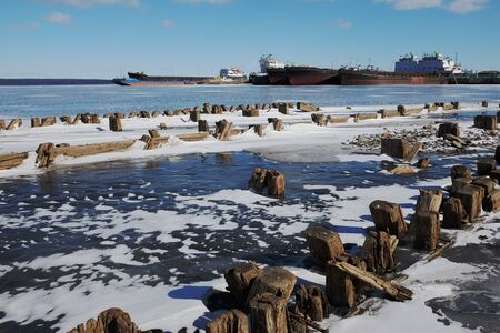 remains: remains of a wooden pier and ships in port in Petrozavodsk, Russia
