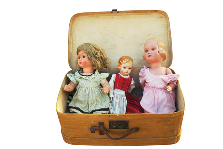 vintage doll: three vintage doll in an old wooden suitcase