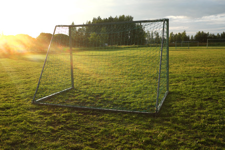 level playing field: soccer goal on the village sports field Stock Photo