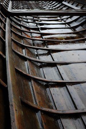 finnish: traditional Finnish church boat in the rain