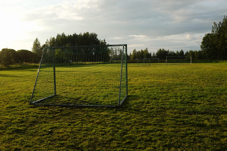 mid distance: soccer goal on the village sports field Stock Photo