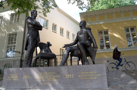 tsar: TURKU, FINLAND, AUGUST 2, 2013: Swedish Crown Prince Carl Johan and the Russian Tsar Alexander I at the meeting in the Finnish city of Turku. The monument is located in the city center on the banks of the River Aura. Author, sculptor Andrei Kovalchuk.