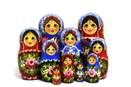 matroshka: lot of traditional Russian matryoshka dolls on white background