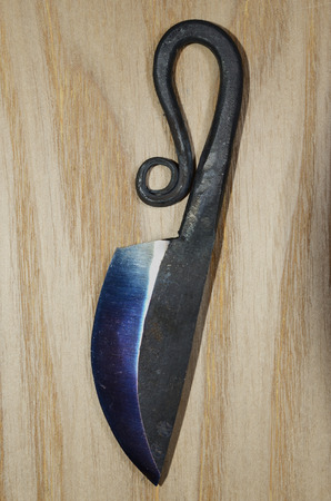 made in finland: traditional finnish knife puukko on wooden background