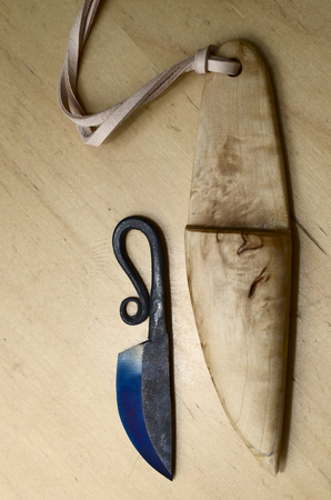 sheath: traditional finnish knife puukko and wooden sheath on a table