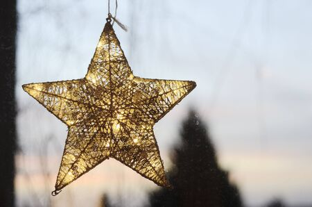evening sky: Christmas star on a window against the evening sky