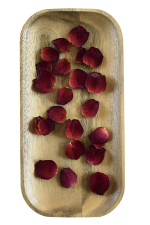 red rose petals: red rose petals on a wooden tray Stock Photo