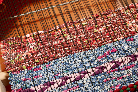 loom and woven fabric to the traditional pattern Stock Photo