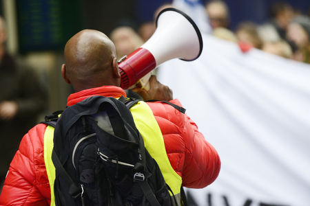 an activist with megaphone during the protest action