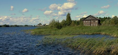 onega: traditional wooden house on the shore of Lake Onega, north Russia