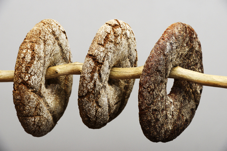 centenary: three finnish round rye bread on a neutral background Stock Photo